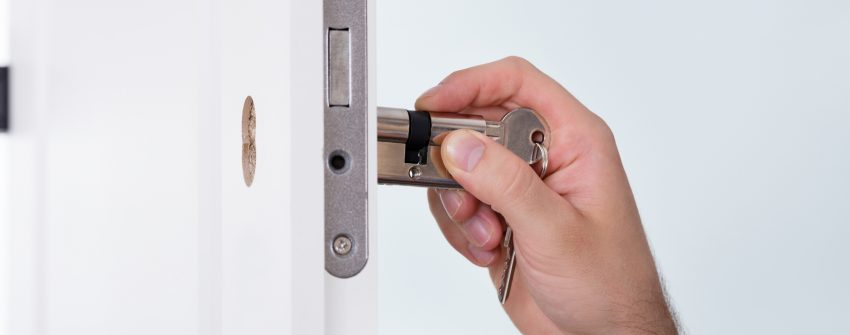 An image of a new lock being fitted to a door