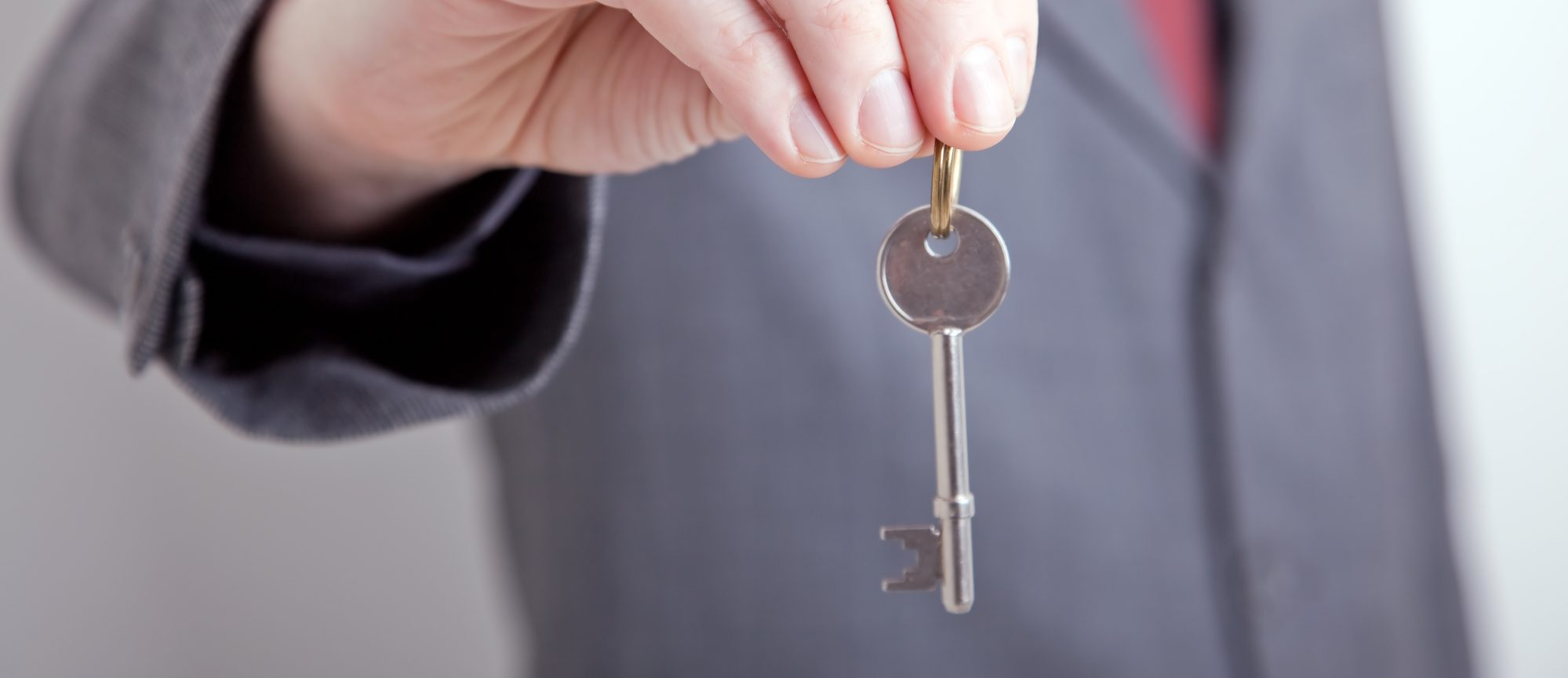 An image of someone holding a key