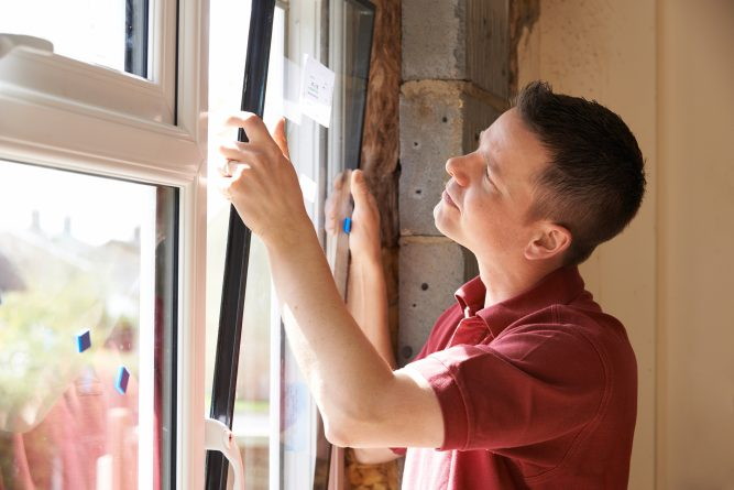 Image of a man installing a window