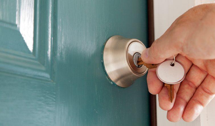 Image of someone unlocking a door