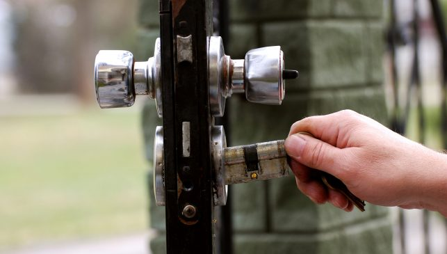 An image of a new lock being fitted to an outside door