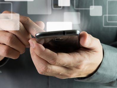 An image of someone holding a phone and scrolling