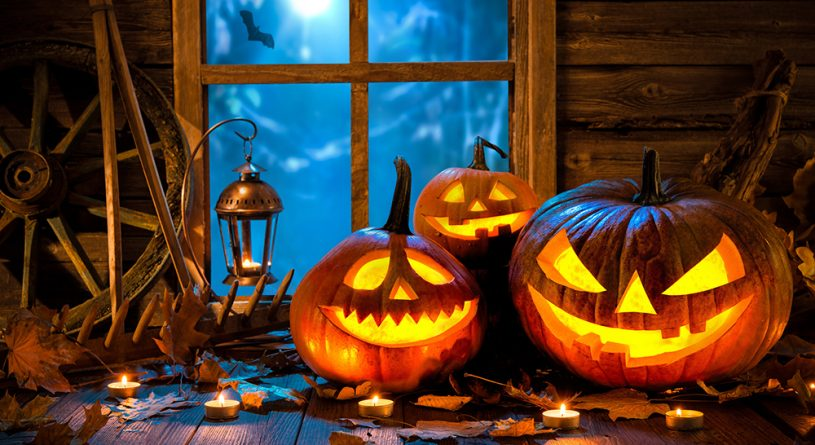 Image of three halloween pumpkins in front of a window