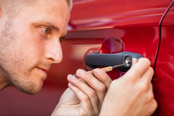 An image of a locksmith unlocking a car door